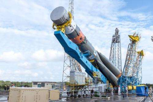 A Soyuz rocket, which on March 27, 2015 was launched carrying two satellites for Europe's Galileo navigation system, is moved fr
