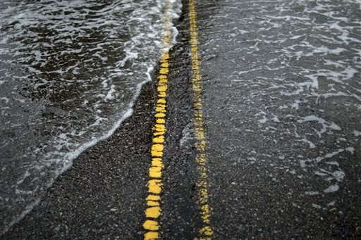 As world talks climate, US city fights flooding, sea rise
