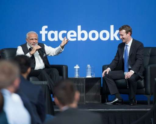Indian Prime Minister Narendra Modi and Facebook CEO Mark Zuckerberg (right) attend a Townhall meeting, at Facebook headquarters