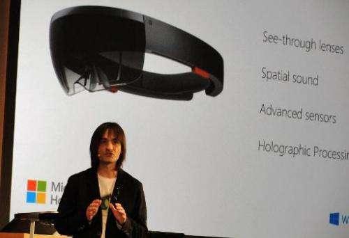 Microsoft executive Alex Kipman speaks at the firm's Redmond, Washington campus as he introduces HoloLens headgear that overlays