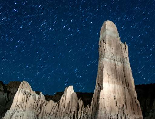 Perseid meteors streak across the sky on August 12, 2013 in Cathedral Gorge State Park, Nevada