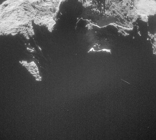Rosetta's comet surrounded by dusty cloud