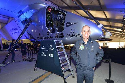 Swiss pilot Bertrand Piccard (R) of the Solar Impulse 2 poses for a photo before their press conference in Nanjing on April 22,