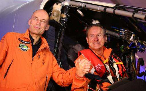 Bertrand Piccard (L) and his compatriot pilot Andre Borschberg seen before flying with the Solar Impulse 2 from al-Bateen airpor