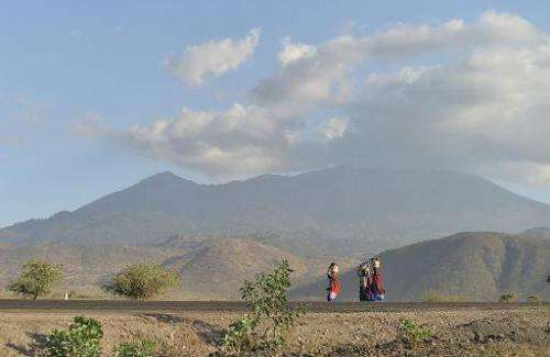 File picture shows Maasai women carrying water in jerrycans on their heads in foothills of Mt. Meru near Arusha, close to the bo