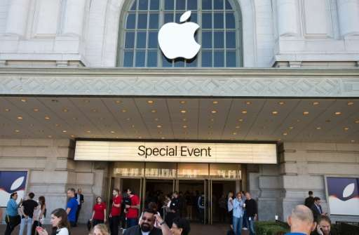 Members of the media gather outside the Bill Graham Civic Auditorium before the start of an Apple event in San Francisco on Sept