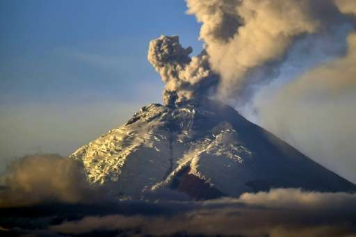 Picture taken from Quito of the Cotopaxi volcano spewing ash on October 8, 2015