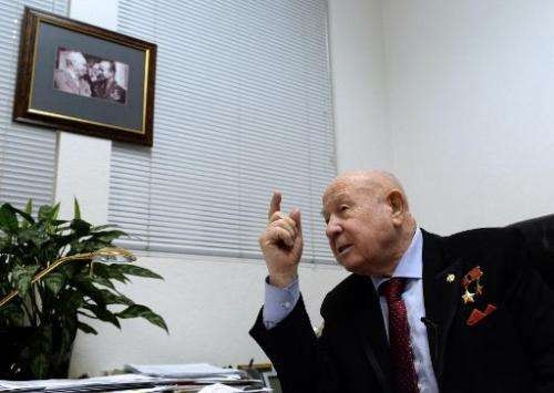 Soviet cosmonaut Alexei Leonov gestures during his interview with AFP in Moscow on March 16, 2015