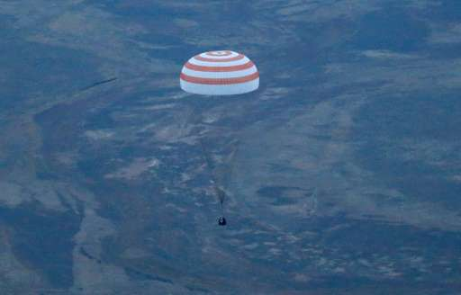 The Soyuz TMA-16M space capsule lands outside Zhezkazgan in Kazakhstan on 12 September 2015