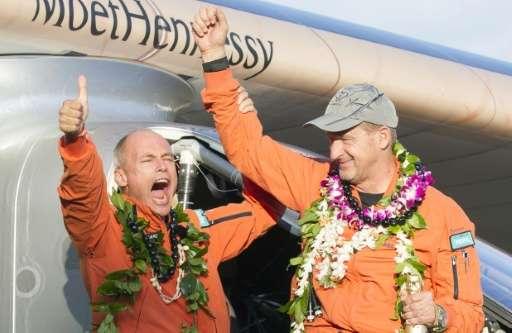 Solar Impulse 2 pilot Bertrand Piccard (L) and pilot Andre Borschberg celebrate after Borschberg landed at Kalaeloa Airport, Haw