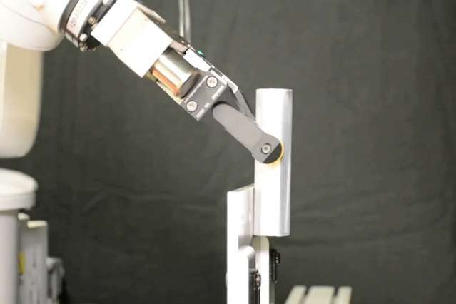 Engineers use the environment to give simple robotic grippers more dexterity