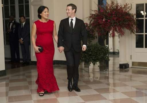 Facebook CEO Mark Zuckerberg and pediatrician Priscilla Chan, pictured at a White House State Dinner on September 25, 2015, have
