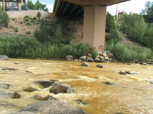 Photo released by the US Environmental Protection Agency (EPA) on August 7, 2015 shows the orange-colored Animas River near Dura