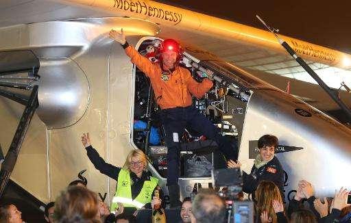 Swiss pilot Bertrand Piccard (C) waves after landing the Solar Impulse 2 at Nanjing's Lukou International Airport on April 22, 2
