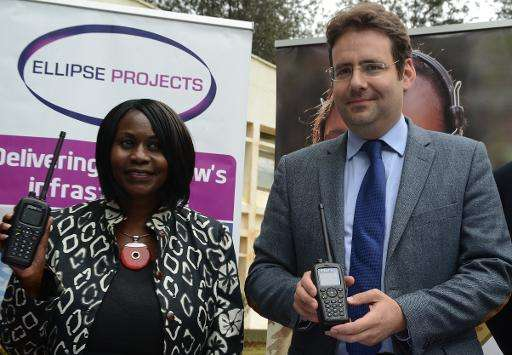 French Minister of Foreign Trade and Tourism, Matthias Fekl (R), and Kenya's environment secretary Judi Wakhungu display pocket
