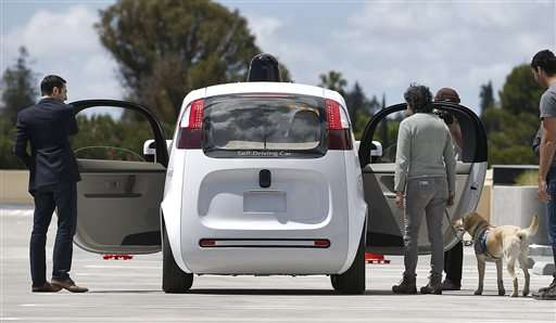 How can people safely take control from a self-driving car?