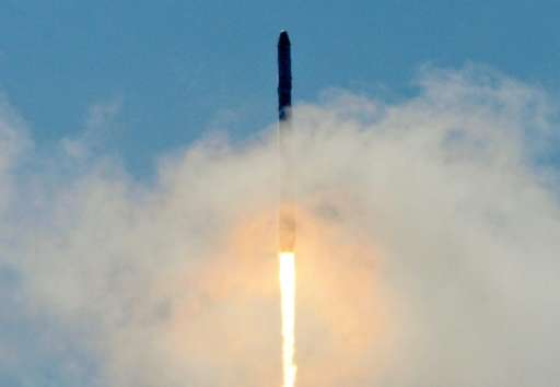 Space X's Falcon 9 rocket as it lifts off from space launch complex 40 at Cape Canaveral, Florida on June 28, 2015