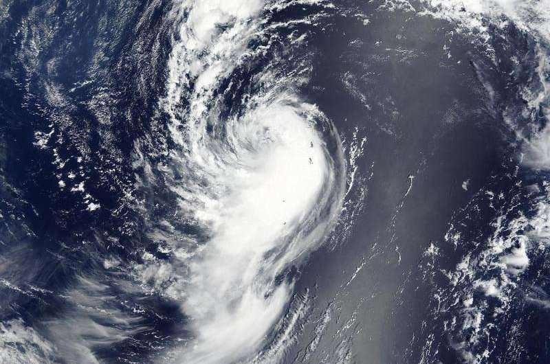 NASA sees Tropical Depression Molave spinning down