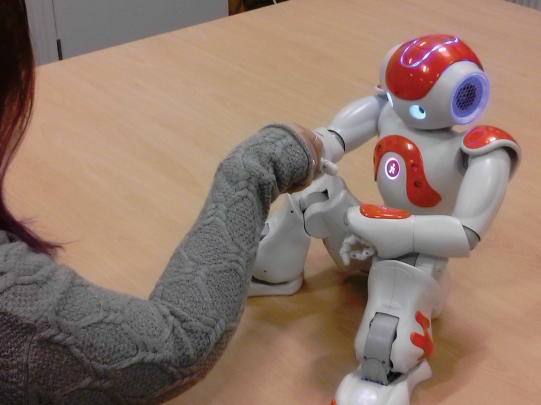Why shaking hands matters (even when it's with a robot)