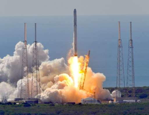 Space X's Falcon 9 rocket as it lifts off from space launch complex 40 at Cape Canaveral, Florida on June 28, 2015 with a Dragon