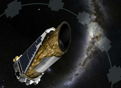 This NASA artist concept obtained December 19, 2014 shows NASA's planet-hunting Kepler spacecraft operating in a new mission pro