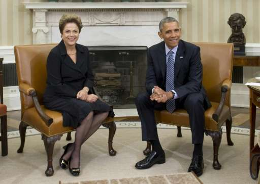 US President Barack Obama (R) and Brazilian President Dilma Rousseff unviel joint renewable energy targets after a meeting at th