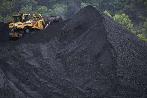 A bulldozer operates atop a coal mound on June 3, 2014 in Shelbiana, Kentucky