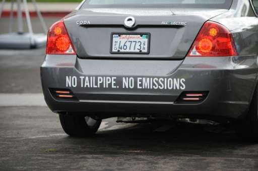 """A Coda electric car with a message reading """"No Tailpipe No Emissions"""" drives in Santa Monica, California on September"""