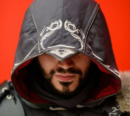 A conference attendee dressed as Ezio from Assassin's Creed Revelation poses for a portrait as he  arrives at the MCN Comic Con