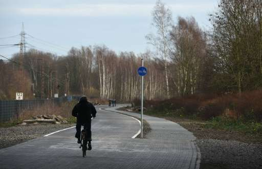 A cyclist enjoys the first five-kilometre (three-mile) stretch of a bicycle highway in Mulheim an der Ruhr, which will connect 1
