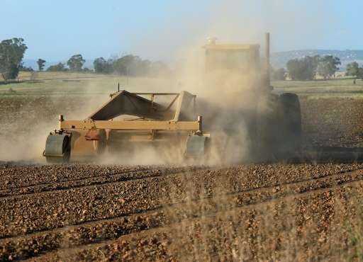 A farmer ploughs his dusty field as a severe drought continues to affect California
