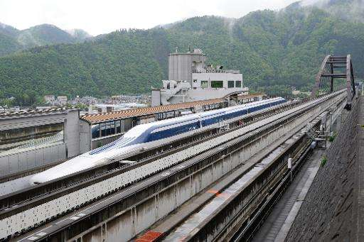 A maglev train leaves the platform for a test run on the experimental track in Tsuru, 100 km west of Tokyo, in 2010
