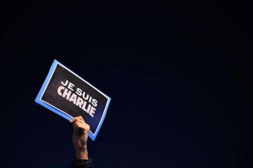 "A man holds a sign reading ""I am Charlie"" in Marseille, France, on January 7, 2015, following an attack by unknown gun"