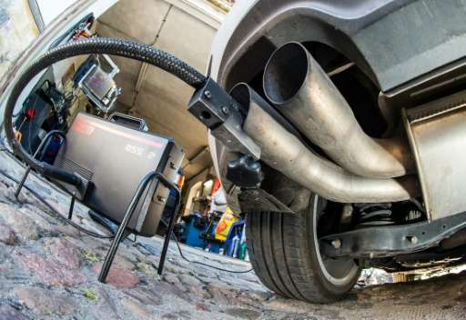 A measuring hose for emissions inspections in diesel engines in the exhaust tube of a Volkswagen Golf 2.0 TDI diesel car at a ga