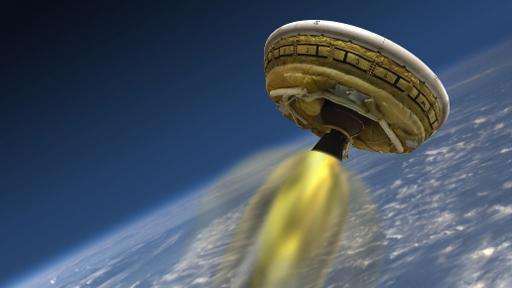 A NASA artist's concept shows the test vehicle for NASA's Low-Density Supersonic Decelerator(LDSD), or flying saucer, designed t