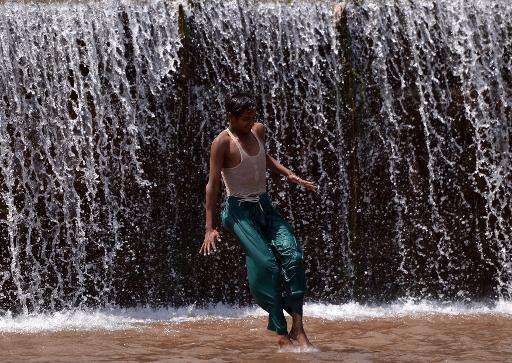 A Pakistani youth cool themselves off at a river during a heatwave on the outskirts of Islamabad on June 22, 2015