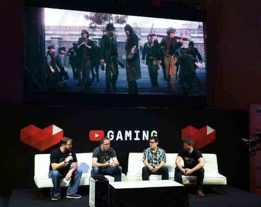 "A panel discusses YouTube's venture into game streaming called ""YouTube Gaming"" at the Electronic Entertainment Expo,"