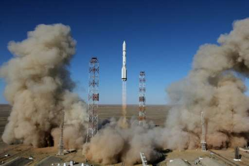 A Russian Proton-M rocket carrying the British communications satellite Inmarsat-5 F3 blasts off from a launch pad at the Russia