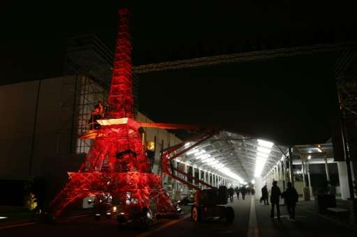 A scale-model Eiffel Tower stands at the site of the Paris climate summit, aka COP21, where negotiators are wrangling over a 54-