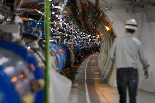 A scientist walks in a tunnel inside the European Organisation for Nuclear Research (CERN) Large Hadron Collider during maintena