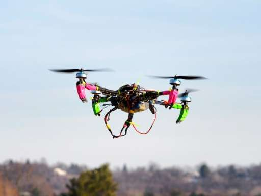 A small, remote-controlled drone hovers in the sky during a meet-up of the DC Area Drone User Group in Middletown, Maryland on F