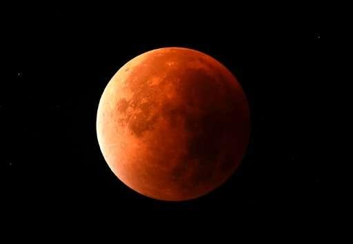 A 'super blood moon' is seen in the sky in Essen, western Germany, on September 28, 2015