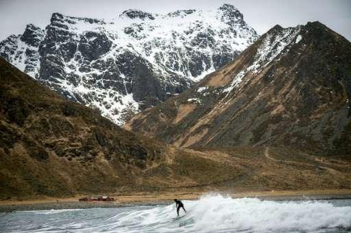A Swedish tourist surfs on Unstad beach in the Lofoten Islands inside the Arctic Circle