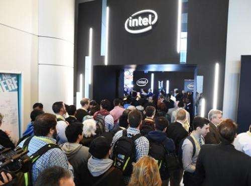 Attendees stream into the Intel stand in the Las Vegas Convention Center as the doors open for the first day of the 2015 Consume