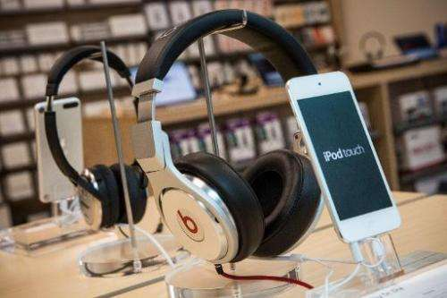 Beats headphones are sold alongside iPods in an Apple store on May 9, 2014 in New York City