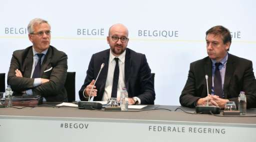 Belgian Defence Minister Steven Vandeput (L) and Prime Minister Charles Michel (C)—pictured with Internal Affairs Minister Jan J