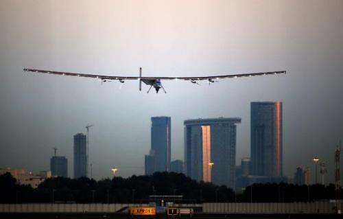 Bertrand Piccard lands the solar-powered plane Solar Impluse 2 at the Al-Bateen airport in Emirati capital Abu Dhabi on March 2,
