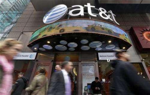 Big costs drag AT&T to 4Q loss, but revenue up 4 percent
