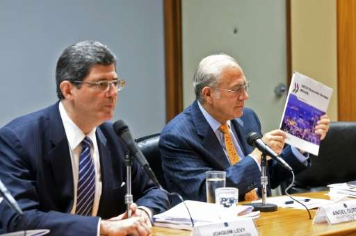 Brazilian Finance Minister Joaquim Levy (L) and the Secretary-General of the Organization for Economic Co-operation and Developm