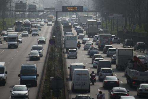 Cars on the peripherique ring road around Paris on March 18, 2015